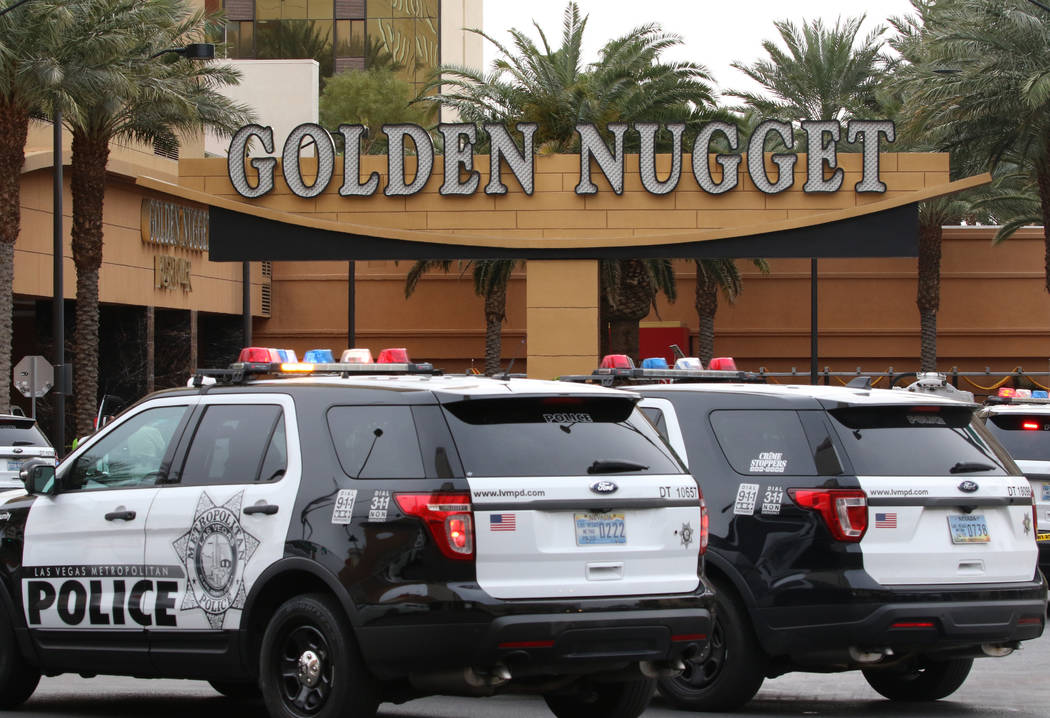 Las Vegas police investigate after a pursuit related to an officer-involved shooting ended at t ...