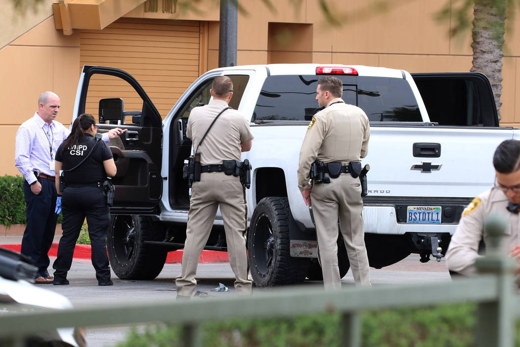 Las Vegas police surround a white pickup truck that was involved in a pursuit related to an off ...