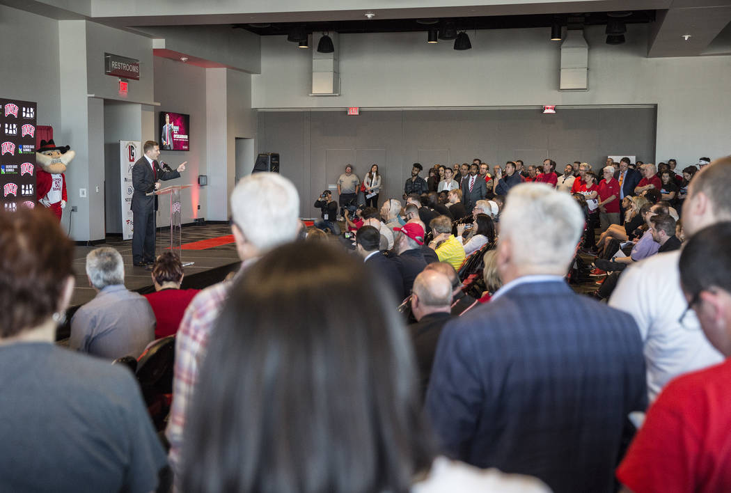 New UNLV men's basketball coach T.J. Otzelberger, left/top, addresses the crowd at the Strip Vi ...