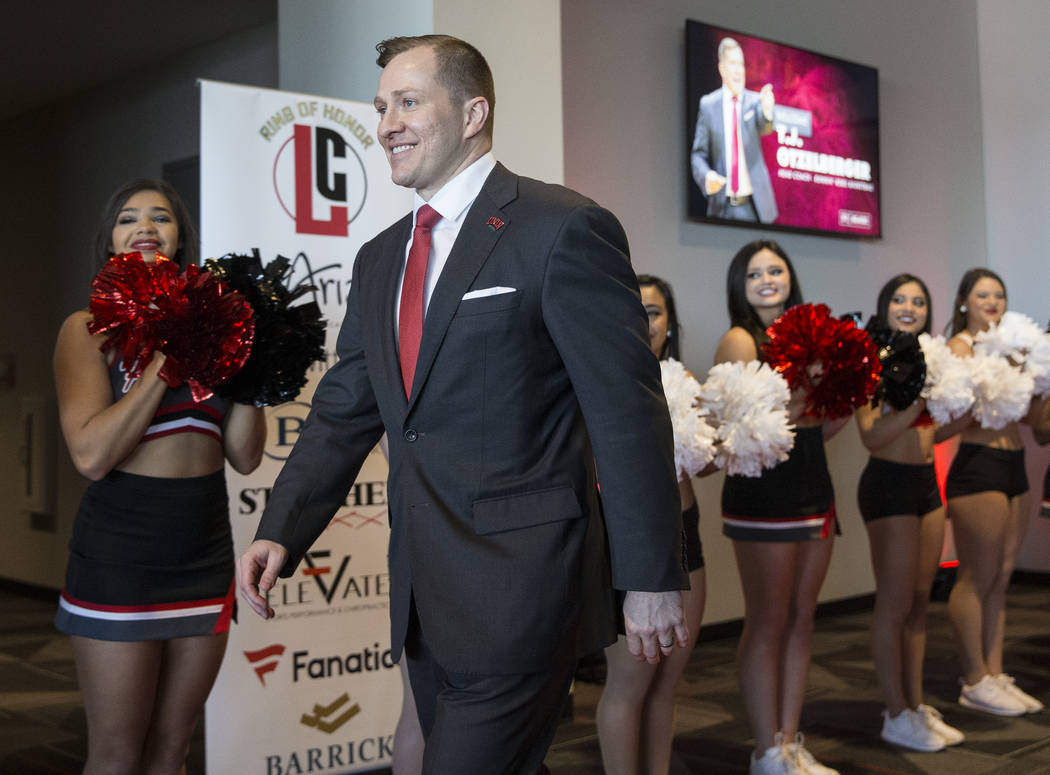 New UNLV men's basketball coach T.J. Otzelberger walks to the podium at the Strip View Pavilion ...