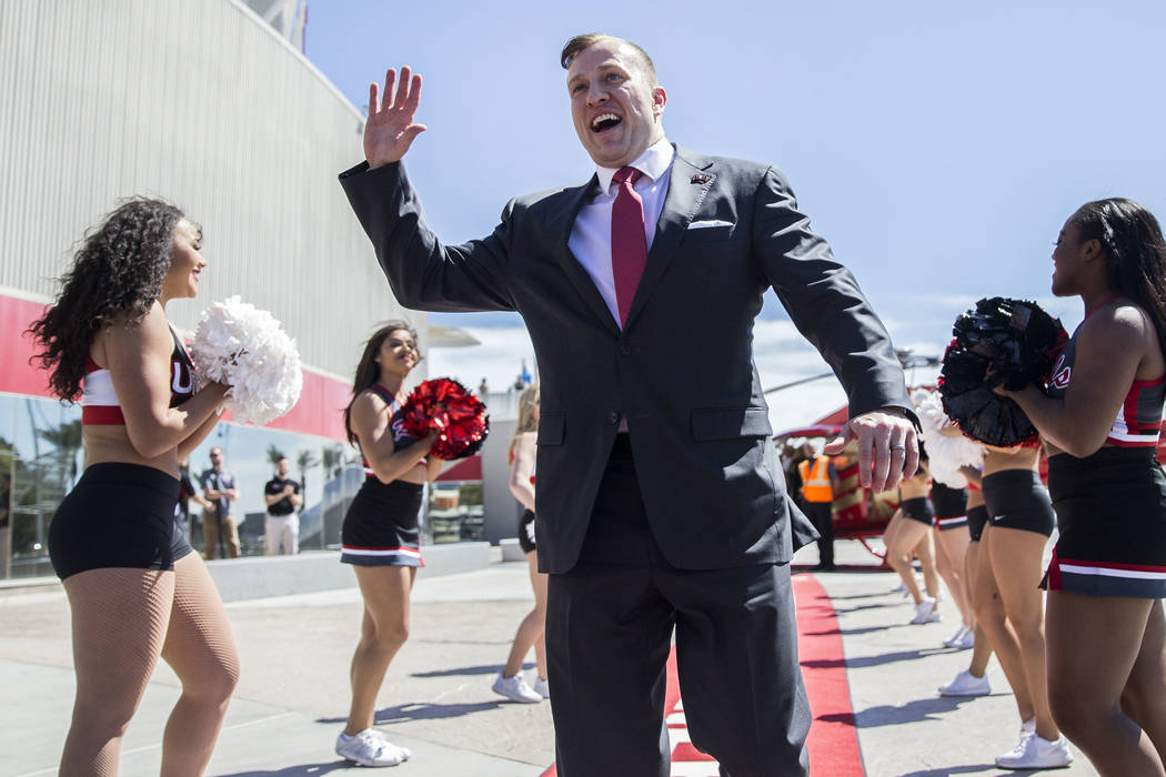 New UNLV men's basketball coach T.J. Otzelberger waves to fans outside the Thomas & Mack Ce ...