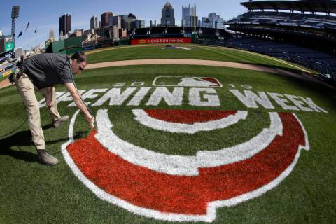 Andy Burnette, of the PNC Ground Crew paints, the Opening Week logo on the field at PNC Park We ...