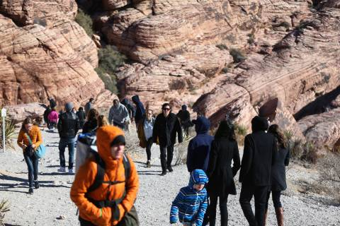 People visit the Red Rock Canyon scenic drive in Las Vegas, Tuesday, Jan. 1, 2019. Erik Verduzc ...