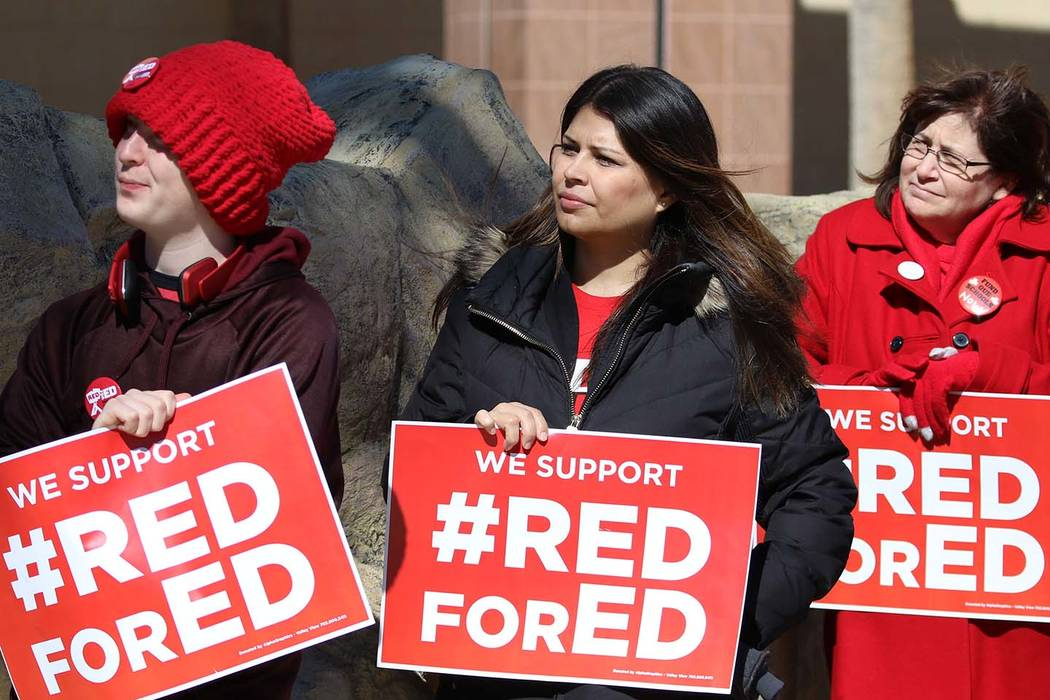 Alec Miller, left, Alicia Norman and Jana Pleggenkuhle demonstrate their support for the ''Red ...