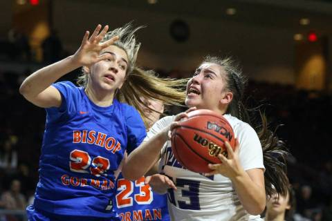 Spanish Springs' Mariah Barraza (33) drives to the net while being guarded by Bishop Gorman's A ...