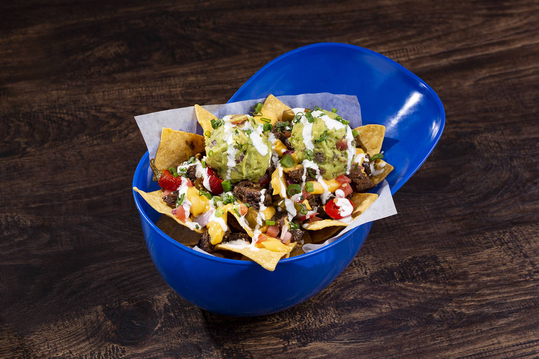 Crunch Time Carne Asada Nachos served in a baseball cap will be available at concessions stands ...