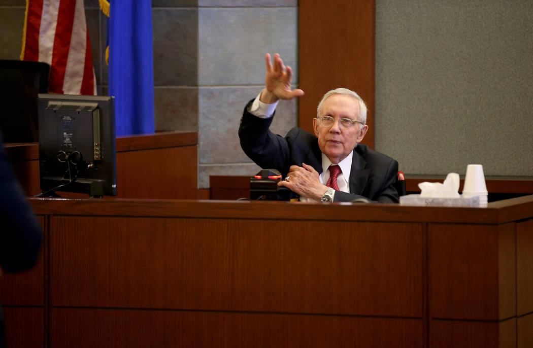 Former U.S. Sen. Harry Reid testifies in the courtroom at the Regional Justice Center in downto ...
