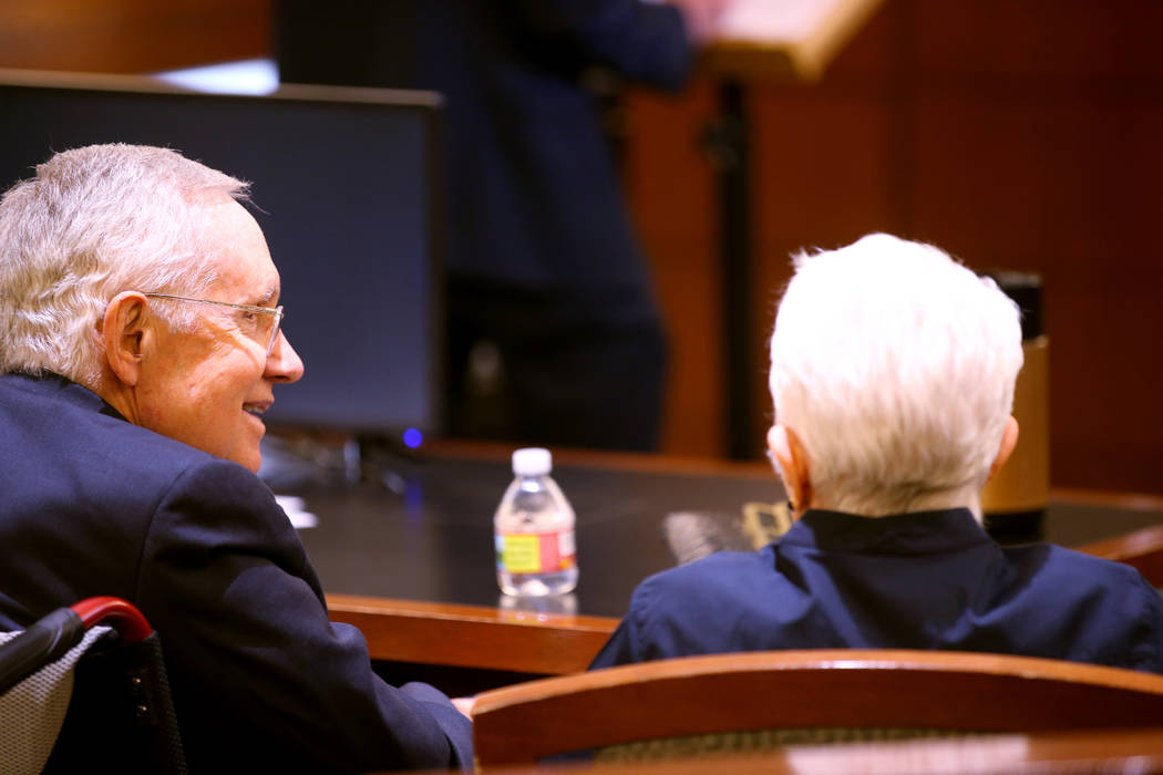 Former U.S. Sen. Harry Reid talks to his wife,Landra Gould, in the courtroom at the Regio ...