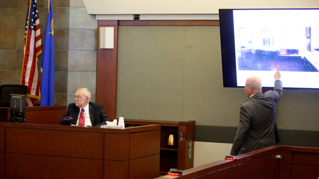 Former U.S. Sen. Harry Reid is questioned by attorney Laurin Quiat in the courtroom at the Regi ...