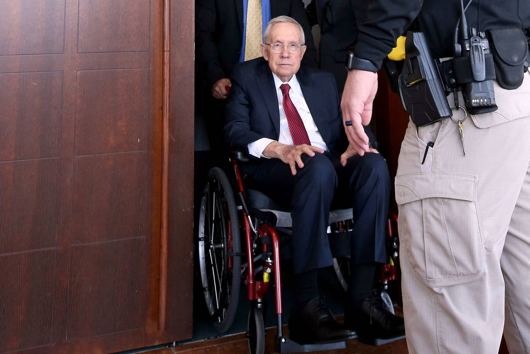 Former U.S. Sen. Harry Reid exits the courtroom at the Regional Justice Center in downtown Las ...