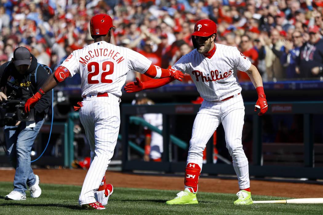Philadelphia Phillies' Andrew McCutchen, left, and Bryce Harper celebrate after McCutchen's hom ...
