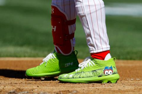 The cleats of Philadelphia Phillies' Bryce Harper are seen during the first inning of an openin ...