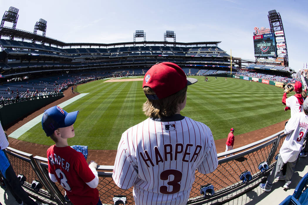 Philadelphia Phillies Bryce Harper fans watch batting practice ahead of first inning of the ope ...