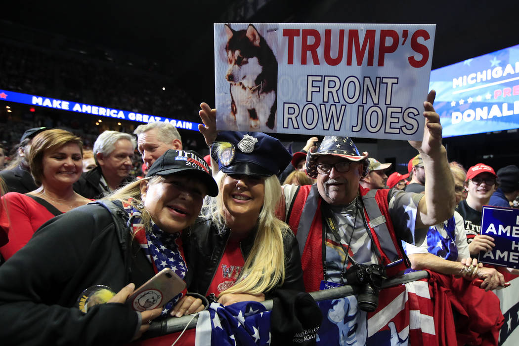 People cheer as President Donald Trump speaks at a campaign rally in Grand Rapids, Mich., Thurs ...