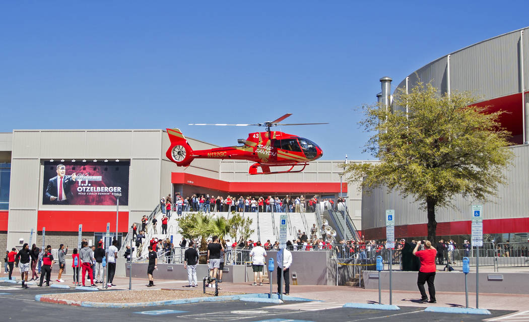 New UNLV men's basketball coach T.J. Otzelberger arrives in style at the Thomas & Mack Cent ...