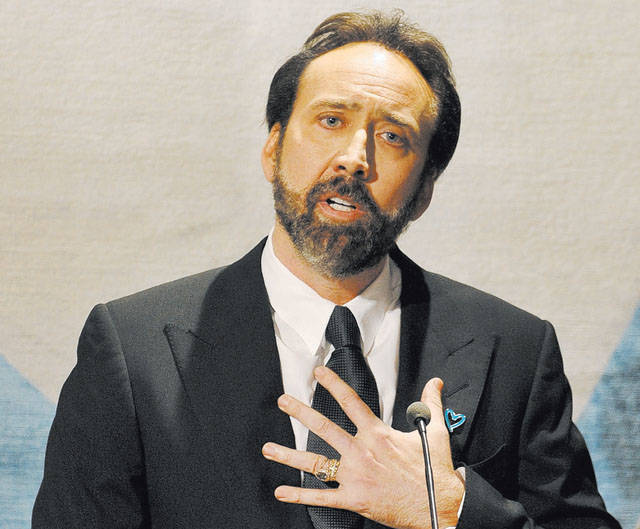 Nicolas Cage delivers a speech during a fund raising event for the United Nations Office on Dru ...