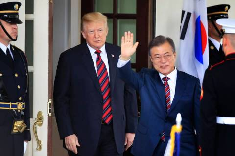 South Korean President Moon Jae-in waves as he is welcomed by President Donald Trump to the Whi ...