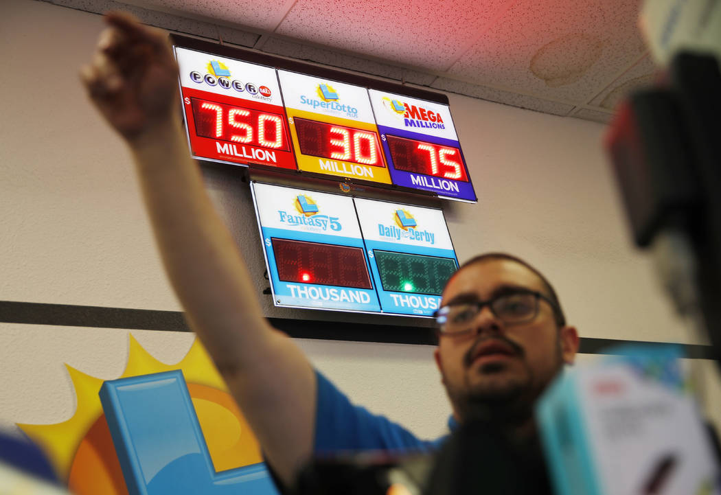 Jackpots, including the Powerball jackpot, are on display at the Lotto Store at Primm just insi ...