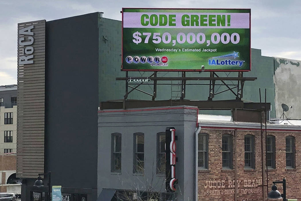 A billboard promotes an estimated $750 million Powerball jackpot in downtown Des Moines, Iowa, ...