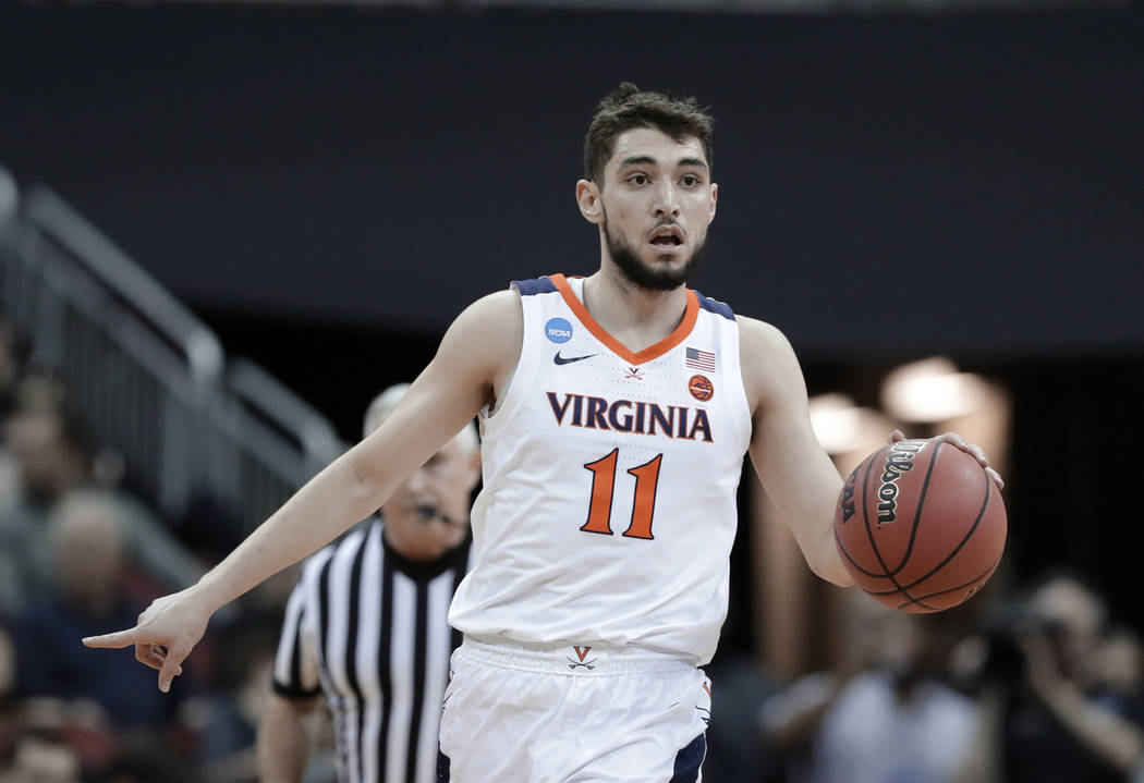 innovative design a208e d9db6 Virginia guard Ty Jerome plays against Oregon during the first half of a  men s NCAA Tournament