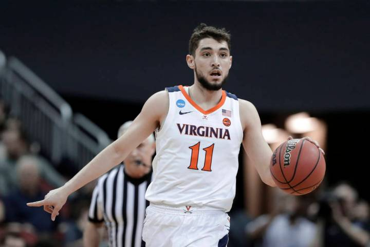 Virginia guard Ty Jerome plays against Oregon during the first half of a men's NCAA Tournament ...