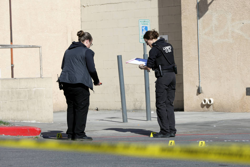 Las Vegas police crime scene investigators document evidence at a gas station at the corner of ...