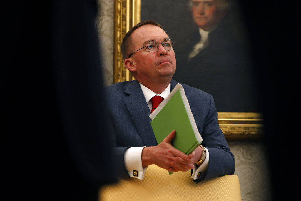 Acting White House chief of staff Mick Mulvaney listens as President Donald Trump speaks during ...