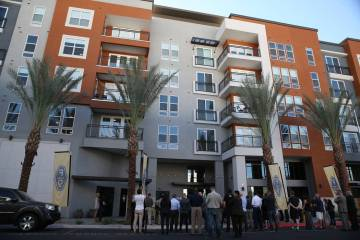 People attend the grand opening ceremony at Fremont9, a new apartment complex in downtown Las V ...