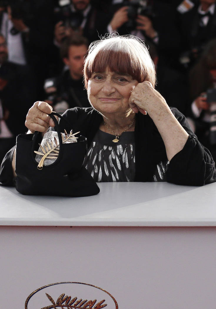 FILE - In this Sunday, May 24, 2015 file picture, director Agnes Varda holds the Honorary Palme ...
