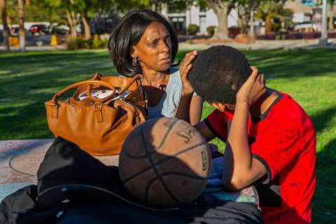 Reponzia Catron and her son Marion, 16, spend some time in Huntridge Circle Park which has long ...