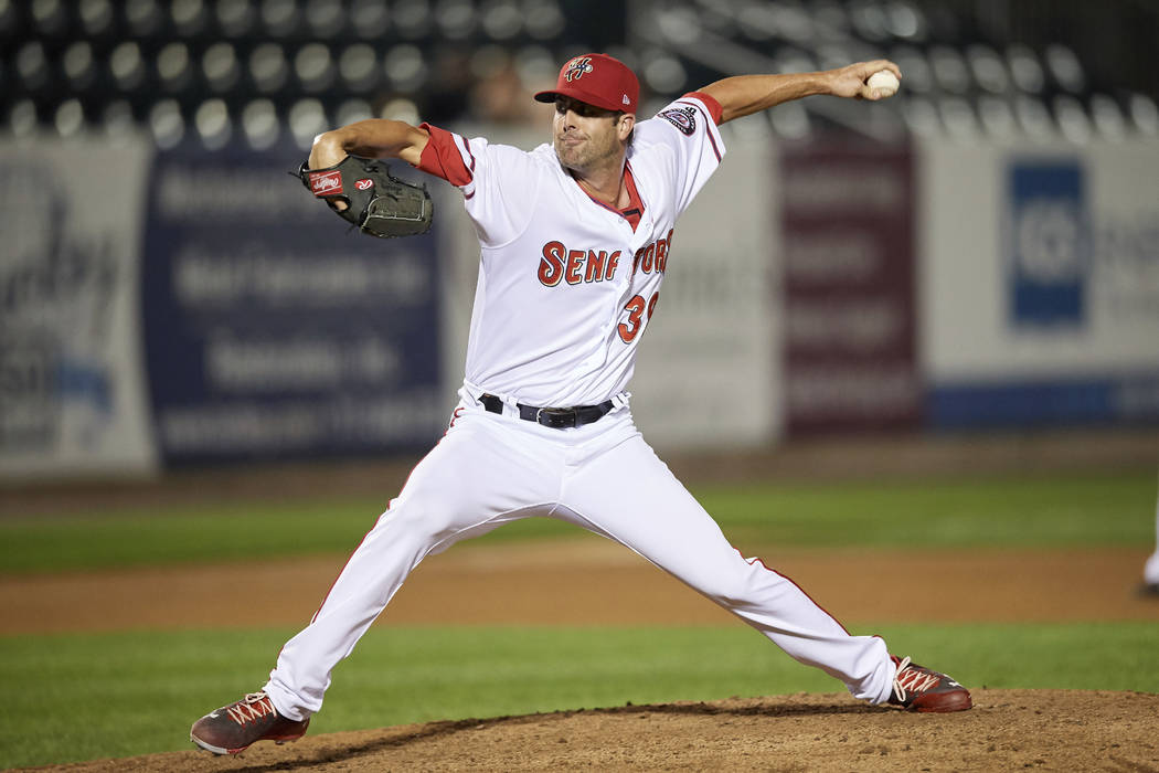 Harrisburg Senators relief pitcher Bryan Harper (39) delivers a pitch during a game against the ...
