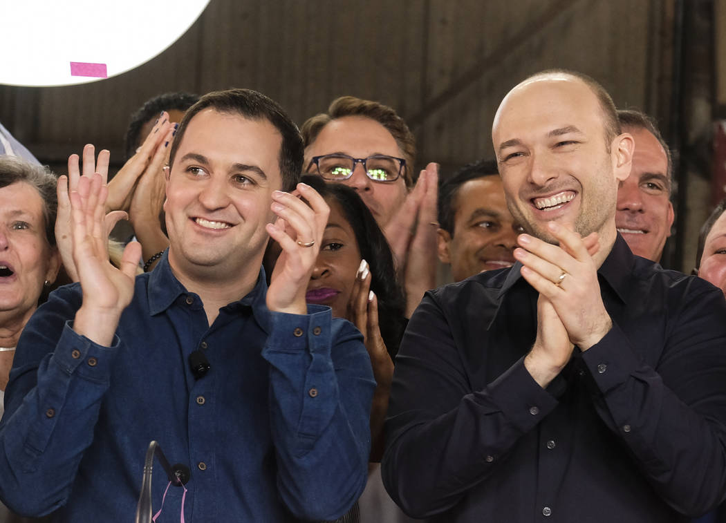 Lyft co-founders John Zimmer, left, and Logan Green cheer as they as they ring a ceremonial ope ...