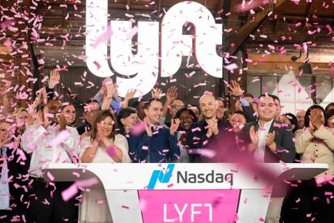 Lyft co-founders John Zimmer, front third from left, and Logan Green, front third from right, c ...