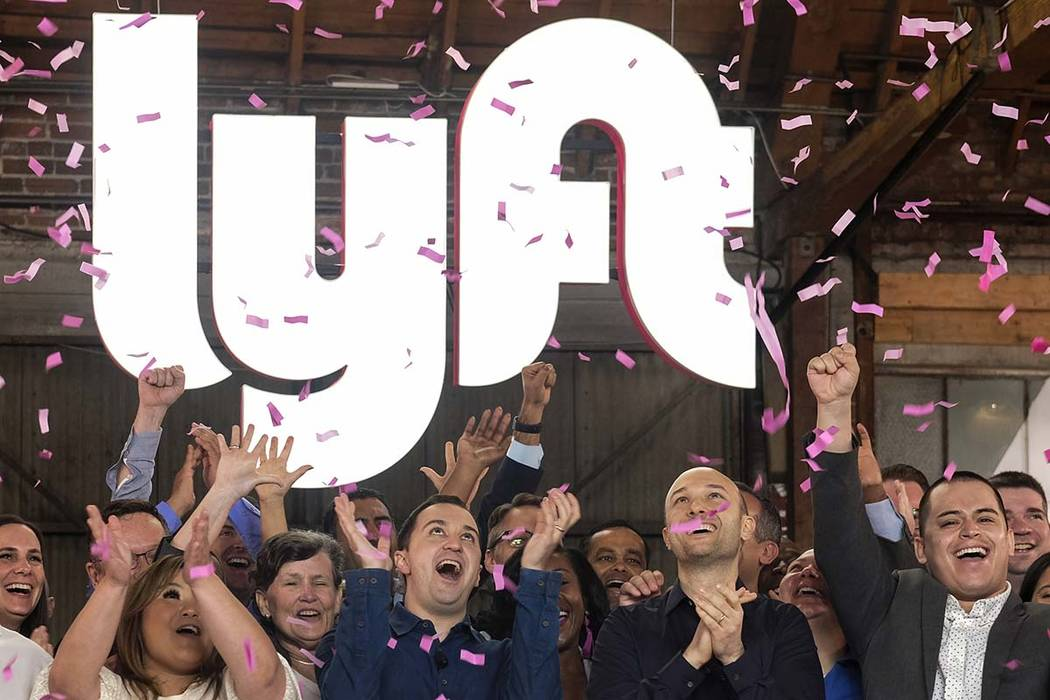 Lyft co-founders John Zimmer, front second from left, and Logan Green, front second from right, ...