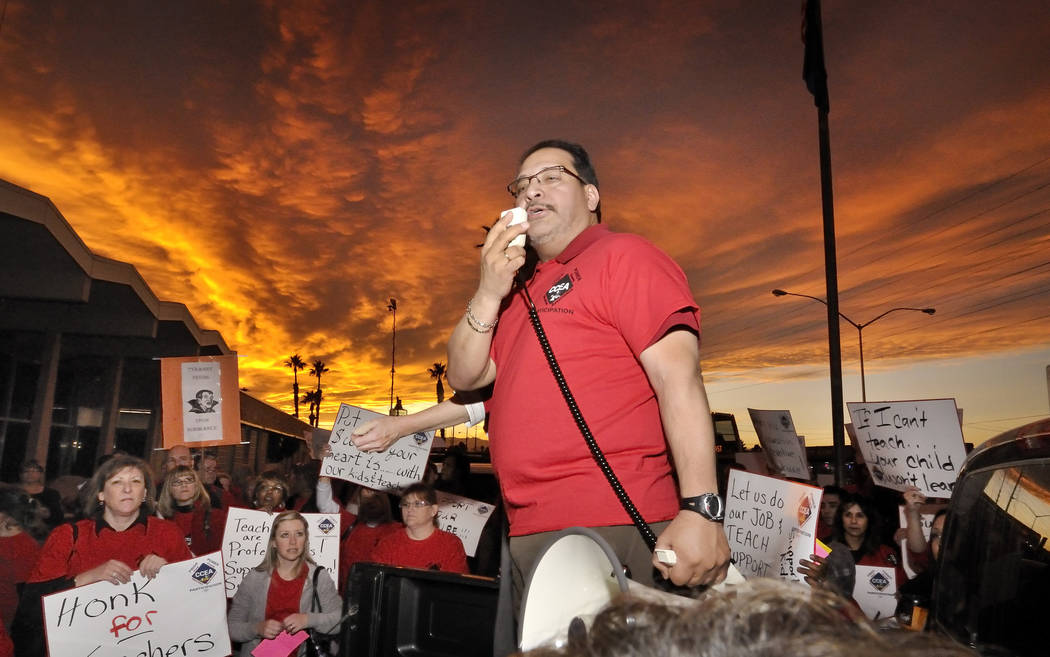 Clark County Education Association President Ruben Murillo, center, speaks during a CCEA rally ...