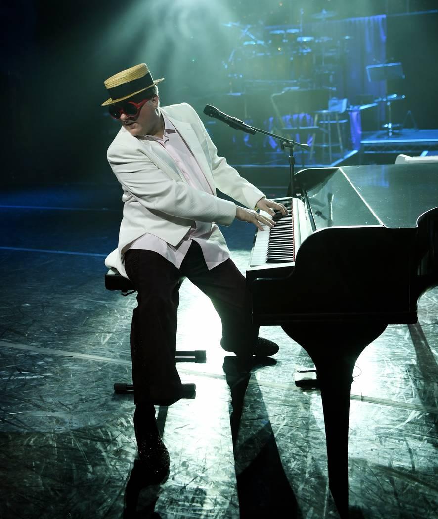 "Greg Ransom portrays Elton John in ""The Greatest Piano Men"" at Flamingo Las Vegas. (Denise Trus ..."
