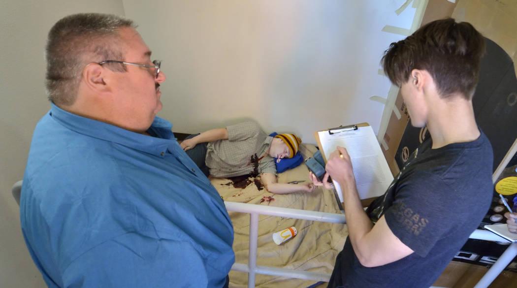 Student Ben Lieberman, right, takes notes under the eye of Daniel Holstein, retired crime scene ...