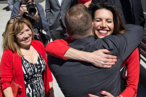 UNLV athletic director Desiree Reed-Francois, right, hugs new UNLV men's basketball coach T.J. ...