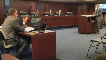 Karl Bennison, chief of the state Gaming Control Board's Enforcement Division, left, answers qu ...