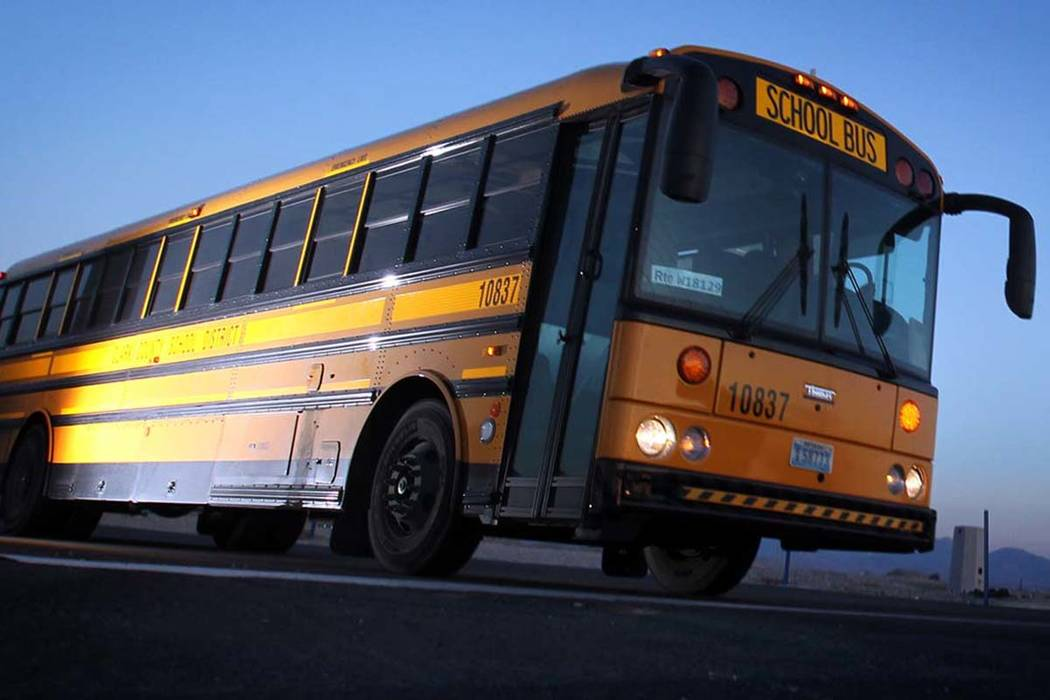 A Clark County School District bus leaves the Wallace Bus Yard in Henderson. (Jeff Scheid/Las V ...