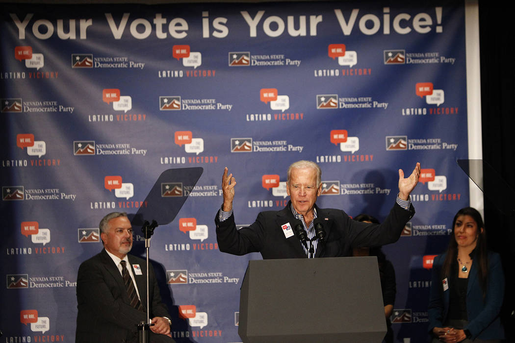 Vice President Joe Biden, center, speaks during a get out the vote event, with Henry R. Mu&#xf1 ...
