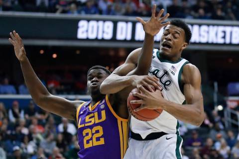Michigan State forward Xavier Tillman (23) beats out LSU forward Darius Days (22) for the loose ...