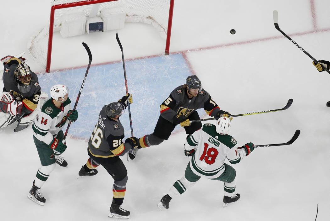 Minnesota Wild center Joel Eriksson Ek (14), Vegas Golden Knights center Paul Stastny (26), def ...