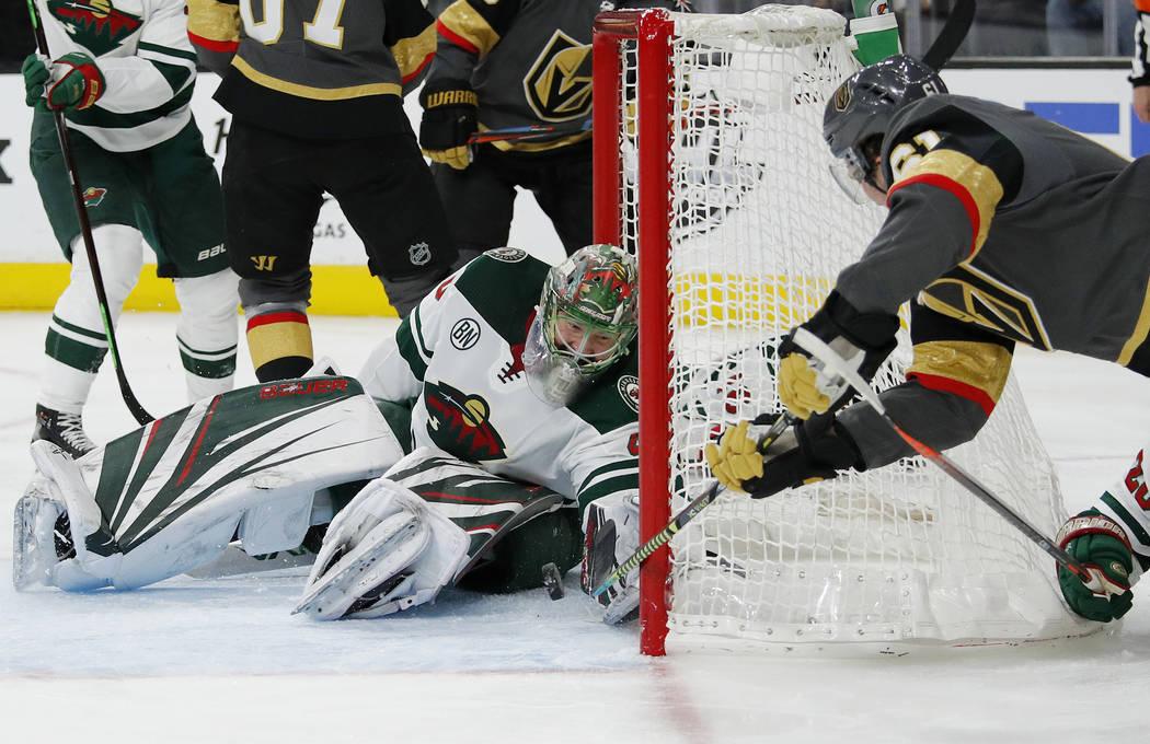 Minnesota Wild goaltender Devan Dubnyk makes a glove save against Vegas Golden Knights right wi ...