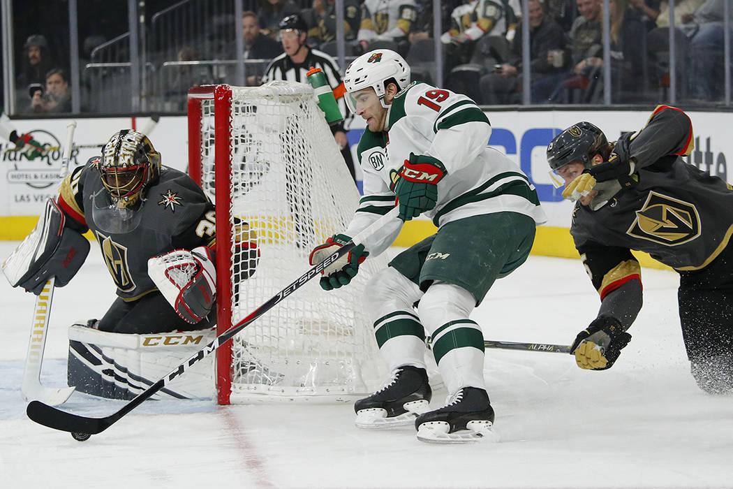 Minnesota Wild center Luke Kunin (19) shoots against Vegas Golden Knights goaltender Malcolm Su ...