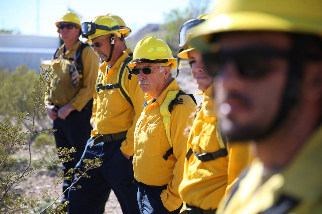 Faron Madderra, center, firefighter emergency medical technician, participates during a traini ...