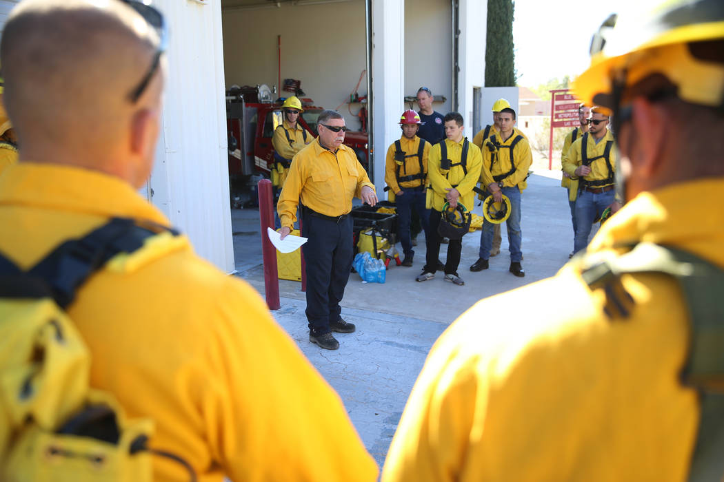 Larry Haydu, center, assistant fire chief for the Clark County Fire Department, gives instructi ...