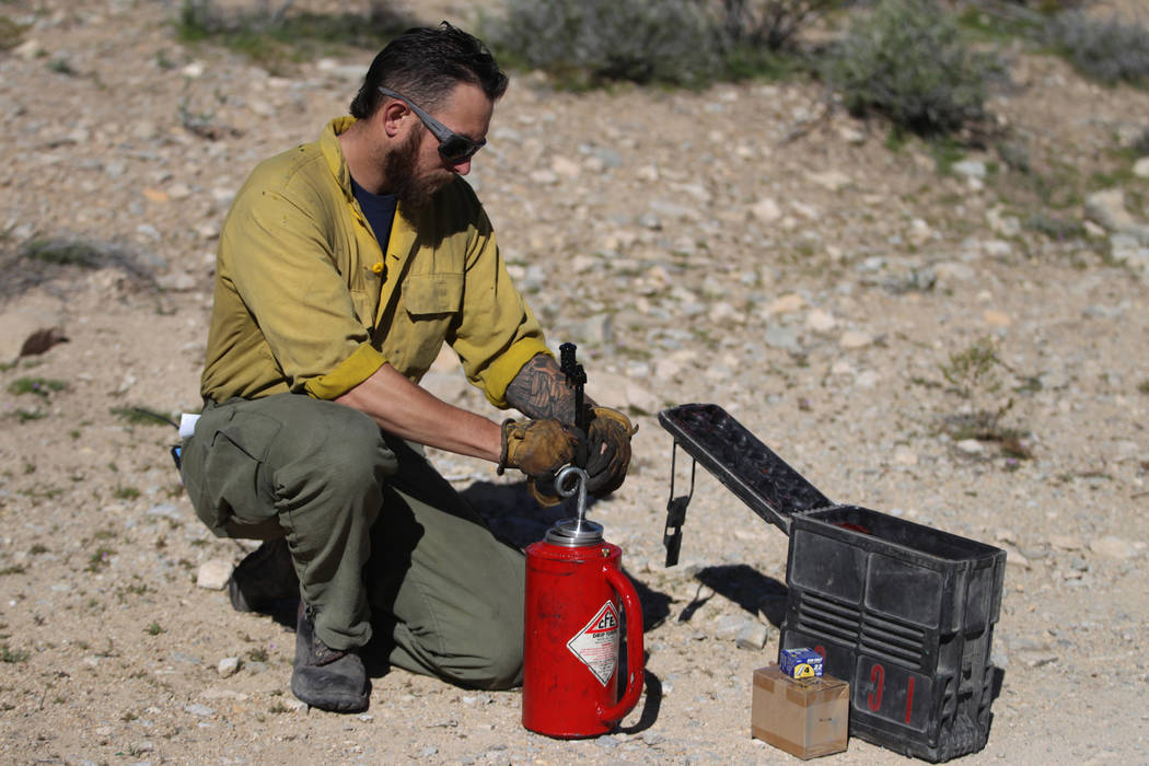 Kenneth Fruend, senior firefighter for the Bureau of Land Management at Red Rock, teaches how t ...