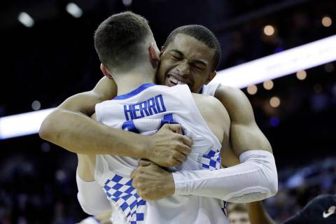 Kentucky's PJ Washington celebrates with teammate Tyler Herro near the end of a men's NCAA tour ...