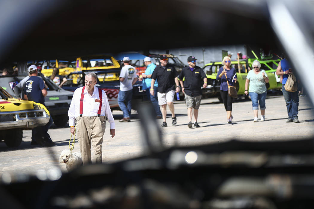 Don Mitchell, of Henderson, and his dog, Scout, walk through the pit area before the start of t ...